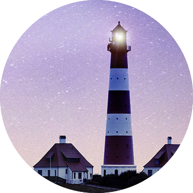 Elibrary image: lighthouse with background of stars at dawn